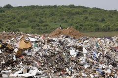 Nedgrävning av soporplats Arkivfoto