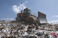 Nedgrävning av soporplats Fotografering för Bildbyråer