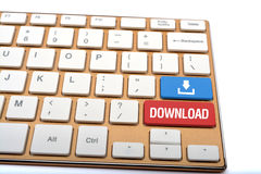 Nedladda nu symbolen med text på tangentbordcloseupen Arkivbilder