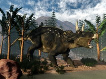 Nedoceratops roaring while running - 3D render Royalty Free Stock Images