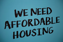 We need affordable housing blue broadsheet. Written poster concept morgage unaffordable price Royalty Free Stock Photo