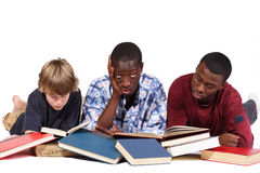 Need a Break. Three boys studying piles of books Stock Photography