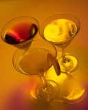 Need company?. Three Martini glasses on colorful background Royalty Free Stock Images