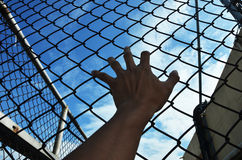 Need freedom with hand in jail Stock Photography