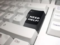 Need Help!. Black enter key on a white keyboard with the following phrase: Need Help Stock Photo