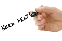 Need help?. Male hand writing Need help? on a virtual whiteboard Royalty Free Stock Images