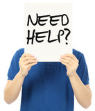 Need Help?. An unrecognizable young man holding up a signboard indicating Need Help Stock Photos