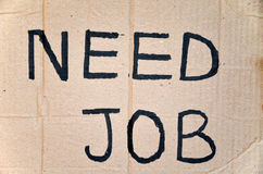 Need job. Written on cardboard Stock Photography