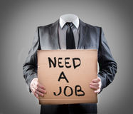 Need a job. Businessman holding sign need a job Royalty Free Stock Photo