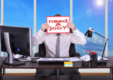 Need a job. Businessman in office holding clipboard with need a job Royalty Free Stock Image