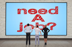 Need a job. Businesspeople looking at big plasma panel with need a job Royalty Free Stock Photos