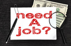 Need a job. Poster with need a job and money in the office Royalty Free Stock Photography