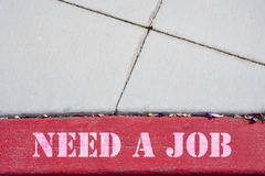 Need a Job. Sign on the parking lot, pavement Royalty Free Stock Photography