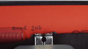 Need job - Typed on a old vintage typewriter. Printed on red paper. The red paper is inserted into the typewriter.  stock video