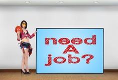 Need a job. Woman builder holding big plasma panel with need a job Royalty Free Stock Image