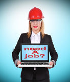 Need a job. Woman engineer holding laptop with need a job Royalty Free Stock Images