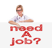 Need a job. Young female doctor pointing to poster  with need a job Stock Images