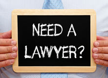 Need a Lawyer - Businessman with chalkboard. Need a Lawyer - Businessman holding chalkboard with text in his hands stock images