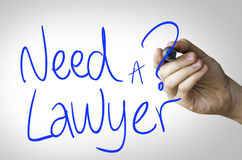 Need a Lawyer hand writing on blue marker on transparent wipe board.  Stock Image