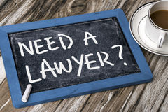 Need a lawyer?. Need a lawyer handwritten on blackboard