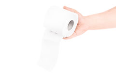 Need this. Male hand holding out toilet paper isolated on white background Stock Image