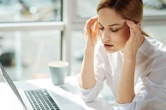 Serious female person sitting with closed eyes Stock Images