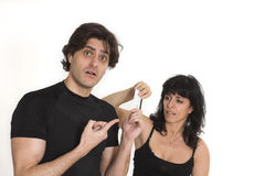 In need for money. Woman taking money from man over white background Stock Photo