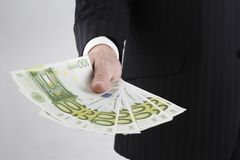 Need money : euro. Hand giving or showing 100s of euro in his hand Royalty Free Stock Photography