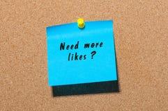 Need More Likes card pinned at notice board.  Royalty Free Stock Photos