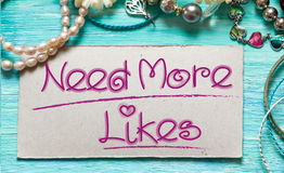 Need more likes. Conceptual inspirational quotes Royalty Free Stock Images