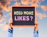 Need More Likes? word on blackboard. Stock Photo