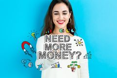 Need More Money text with young woman. On a blue background Royalty Free Stock Photos