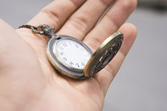 Pocket watch. In hand royalty free stock photo