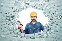 Need a service. 3d brick explosion and handyman with hand drill royalty free stock images