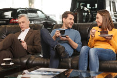 They need some break to make a right choise. Three car dealershi Stock Images