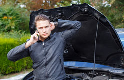 Need some help. Picture of a worried young man because his car broke stock images