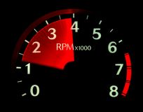Need for Speed. Vehicle's illuminated tachometer revving up at night Stock Images