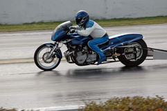 The need for speed. Motorcycle racing against the clock Stock Image