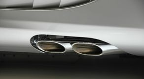 Need for speed. Modern stylish sportscar showing exhaust Royalty Free Stock Images