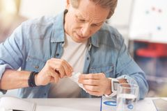 Unhealthy adult man going to take pills Stock Photos