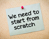 We need to start from scratch. Message. Recycled paper note pinned on cork board. Concept Image Stock Photos