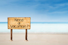 Need a vacation sign on beach. Sign of Need a Vacation? on the beach in Australia Stock Photo