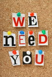 We Need You. The phrase we need you in cut out magazine letters pinned to a cork notice board stock photo