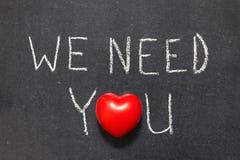 We need you. Phrase handwritten on school blackboard stock images