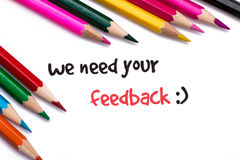 We need your feedback. On white background Royalty Free Stock Photography