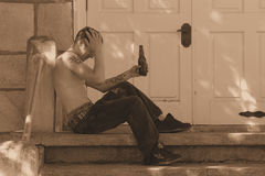 Needing help. Young man who is needing some help, so he sits on church steps royalty free stock images