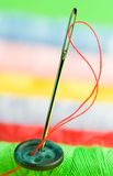 Needle. Close-up of a needle on a colourful background Royalty Free Stock Photo