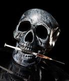 Needle. Skull with needle. Drugs kill Stock Photography