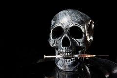 Needle. Skull with needle. Drugs kill Royalty Free Stock Photo