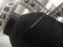 Needle with black thread Stock Photo